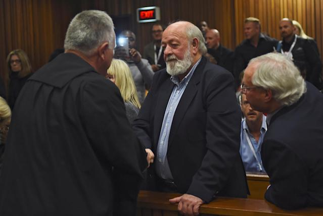 Defence lawyer Barry Roux shakes the hand of Barry Steenkamp after the sentence hearing of Olympic and Paralympic track star Oscar Pistorius at the North Gauteng High Court in Pretoria, South Africa, July 6, 2016. REUTERS/Masi Losi/Pool