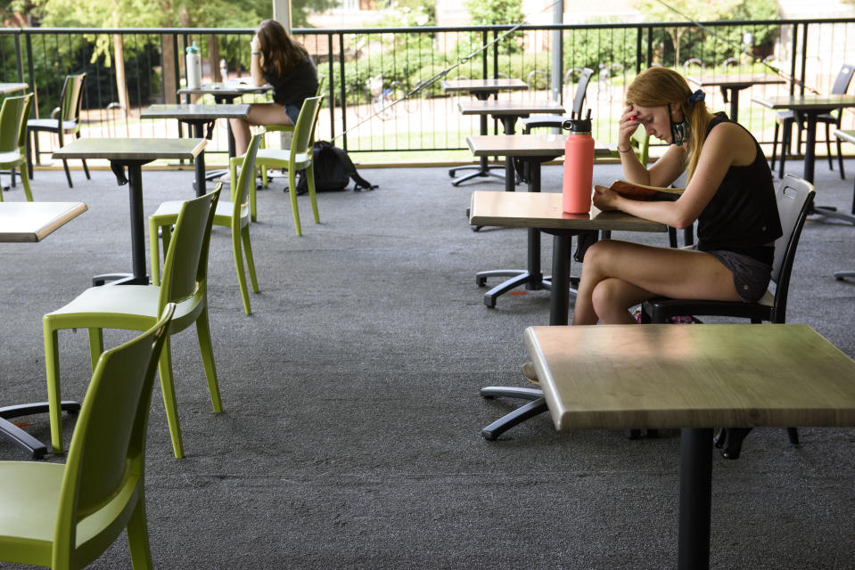 CHAPEL HILL, NC - AUGUST 18: A student studies in an open-air seating area on the campus of the University of North Carolina at Chapel Hill on August 18, 2020 in Chapel Hill, North Carolina. The school halted in-person classes and reverted back to online courses after a rise in the number of COVID-19 cases over the past week. (Photo by Melissa Sue Gerrits/Getty Images)