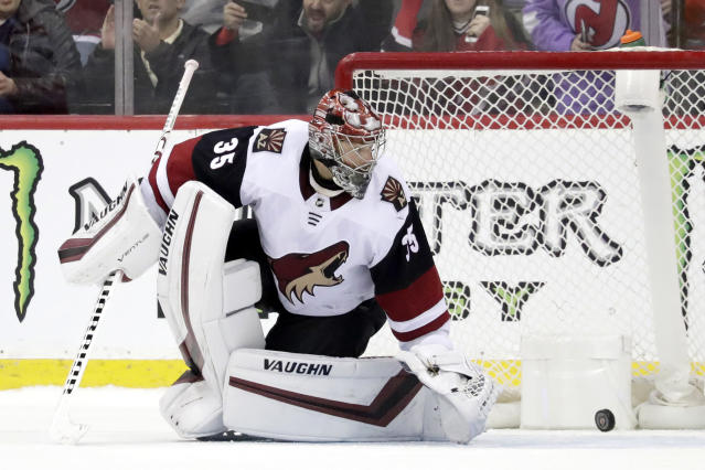 A shootout shot by New Jersey Devils center Pavel Zacha, not visible, of the Czech Republic, gets by Arizona Coyotes goaltender Darcy Kuemper (35) for a goal during an NHL hockey game, Saturday, March 23, 2019, in Newark, N.J. The Devils won 2-1 in a shootout. (AP Photo/Julio Cortez)