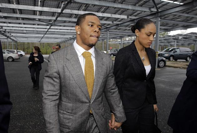 Ray Rice holds hands with his wife Janay Palmer on May 1, 2014. (AP Photo/Mel Evans, File)