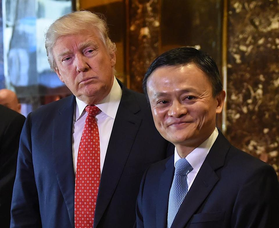 "Jack Ma (R), founder and executive chairman of Alibaba Group, and then President-elect Donald Trump pose for the media after their meeting at Trump Tower January 9, 2017.<span class=""copyright"">TIMOTHY A. CLARY/AFP via Getty Images</span>"