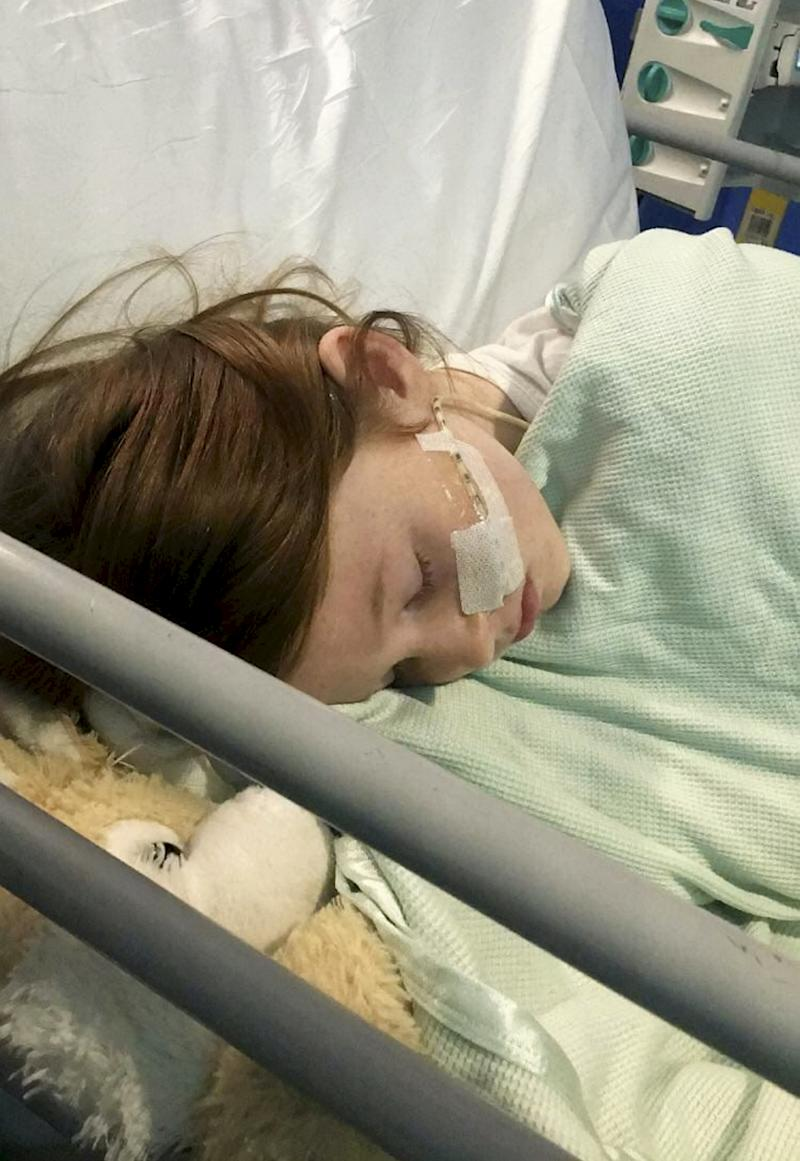 Gracie underwent a three hour operation to remove a blood clot from her brain. [Photo: SWNS]