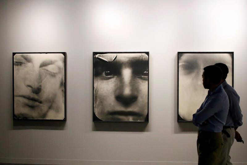 Basel patrons look at works by American Photographer Sally Mann during Art Basel in Miami, Florida, USA, 04 December 2019. EFE/Rhona Wise