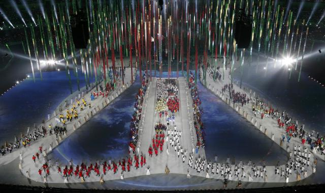 Athletes enter the stadium during the closing ceremony for the 2014 Sochi Winter Olympics, February 23, 2014. REUTERS/Pawel Kopczynski (RUSSIA - Tags: OLYMPICS SPORT)