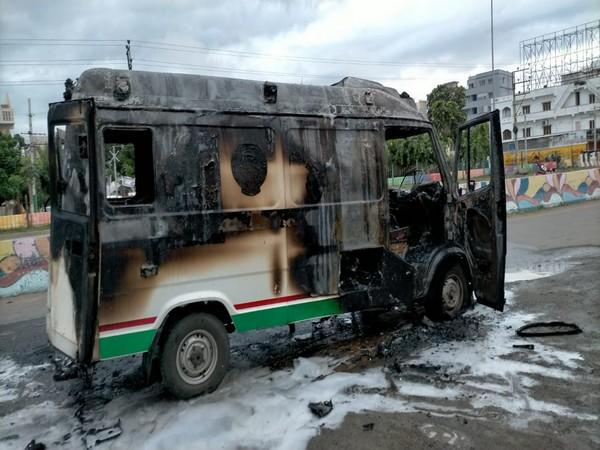 Andhra man set ablaze an ambulance in which he was being taken to hospital in Ongole town. (Photo/ANI)