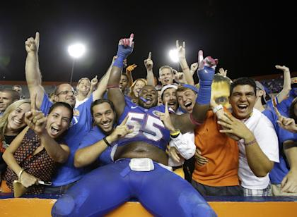 Darious Cummings and the two other suspended Gators are available to play Saturday vs. Eastern Michigan. (AP)