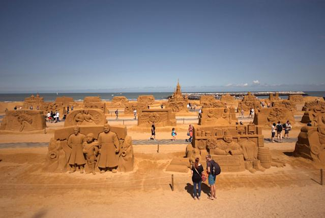 "<p>Visitors at the Sand Sculpture Festival ""Disney Sand Magic"" in Ostend, Belgium. (Photo courtesy of Disneyland Paris) </p>"