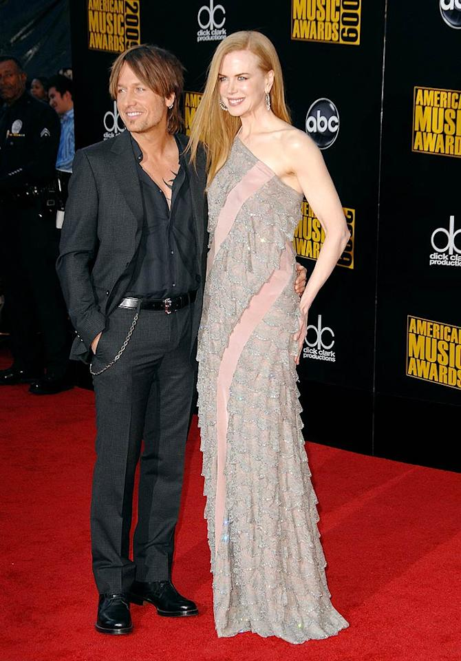 "Keith Urban and Nicole Kidman  Grade: B+  The statuesque beauty impressed in a one-shoulder ruffled gown, while her handsome hubby sported his signature gray suit. Steve Granitz/<a href=""http://www.wireimage.com"" target=""new"">WireImage.com</a> - November 22, 2009"