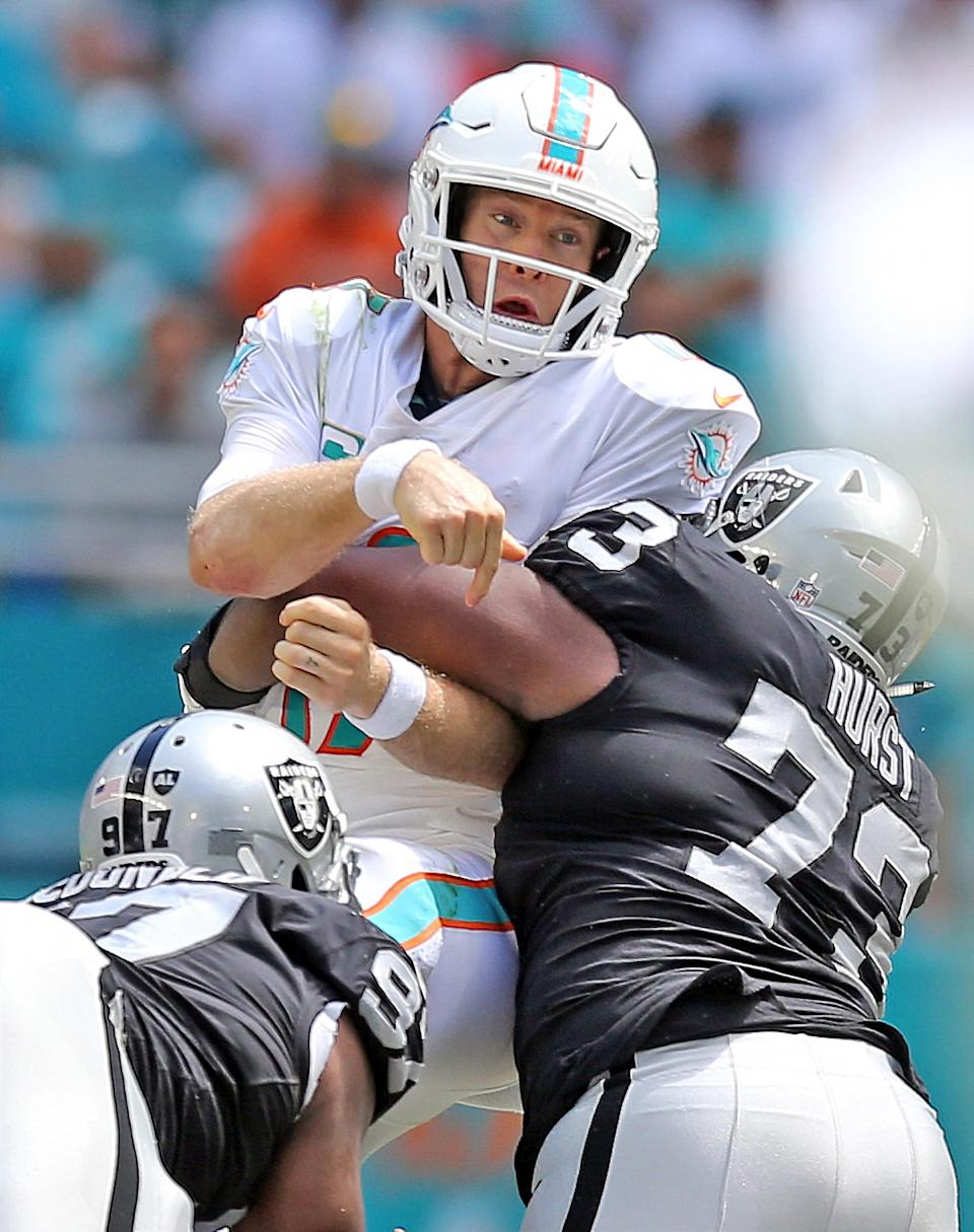 <p>Miami Dolphins quarterback Ryan Tannehill (17) is hit by Oakland Raiders defensive tackle Maurice Hurst (73) in the second quarter on Sunday, Sept. 23, 2018 at Hard Rock Stadium in Miami Gardens, Fla. (Al Diaz/Miami Herald/TNS via Getty Images) </p>