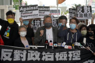 Pro-democracy activist Lee Cheuk-yan, center, arrives at a court in Hong Kong Friday, April 16, 2021. Seven of Hong Kong's leading pro-democracy advocates, including Lee, 82-year-old veteran activist Martin Lee and pro-democracy media tycoon Jimmy Lai, are expected to be sentenced Friday for organizing a march during the 2019 anti-government protests that triggered an overwhelming crackdown from Beijing. (AP Photo/Kin Cheung)