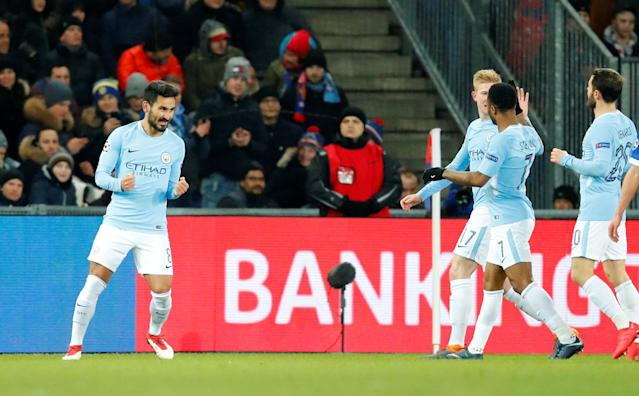 Soccer Football - Champions League - Basel vs Manchester City - St. Jakob-Park, Basel, Switzerland - February 13, 2018 Manchester City's Ilkay Gundogan celebrates scoring their first goal with team mates REUTERS/Denis Balibouse