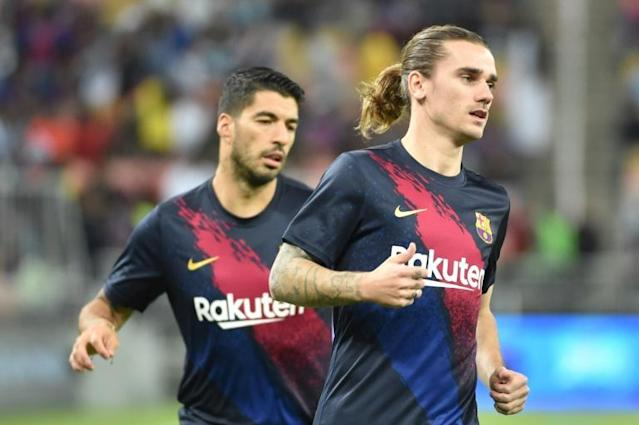 Antoine Griezmann (R) will have a key role to play for Barcelona in the coming months with Luis Suarez out injured (AFP Photo/FAYEZ NURELDINE)