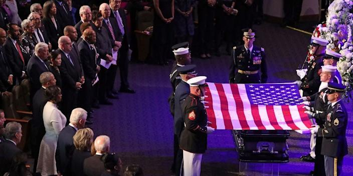 A military honor guard lays the U.S. flag on the casket of Rep. Elijah Cummings during his funeral service on October 25, 2019 in Baltimore, Maryland.