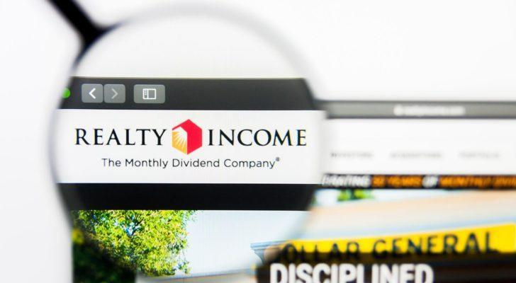 realty income (O) logo highlighted by a magnifying glass on a web browser