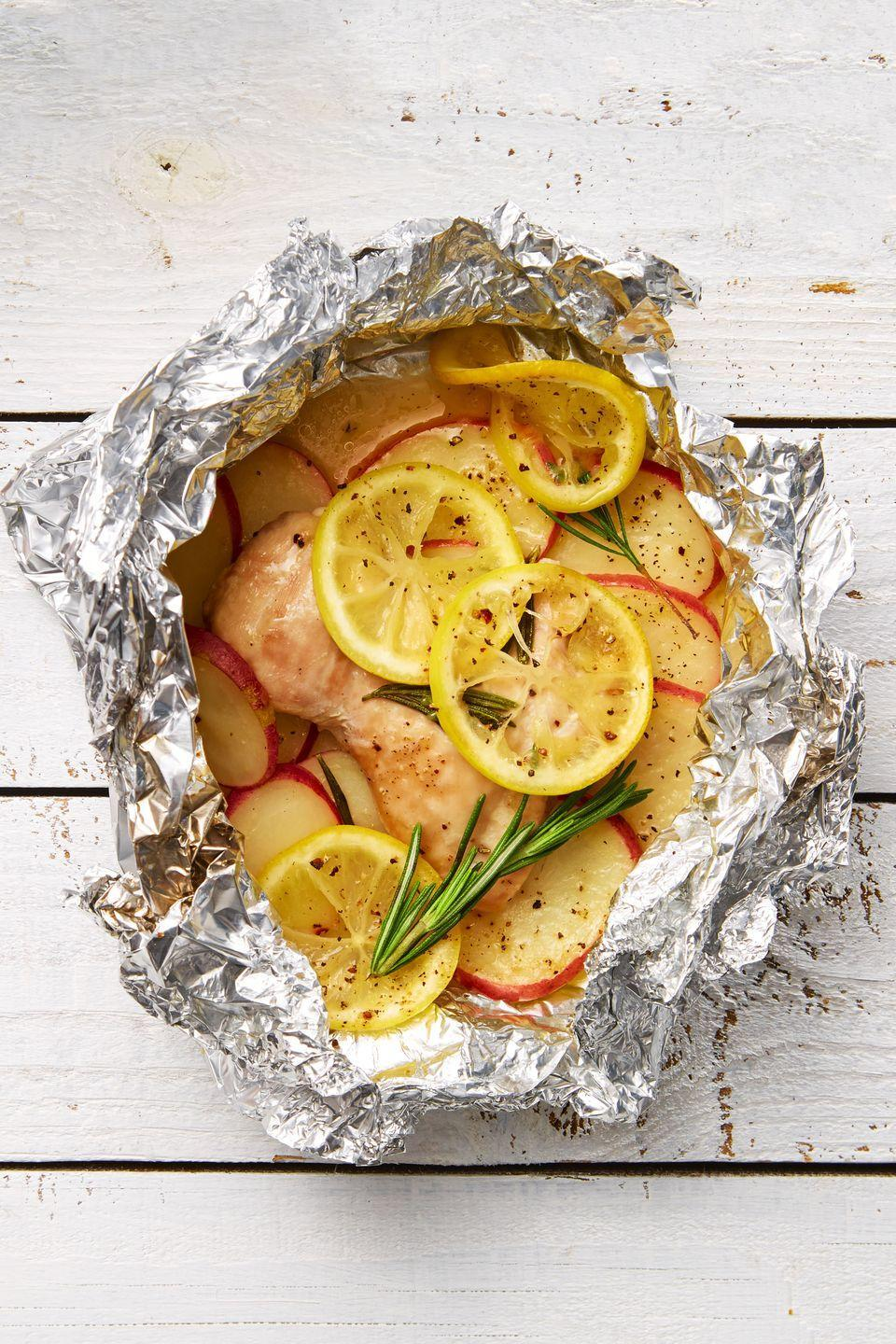 "<p>Dinner's more fun when you get to unwrap it. Oh, and did we mention zero cleanup?</p><p><em><a href=""https://www.goodhousekeeping.com/food-recipes/easy/a34154/lemon-rosemary-chicken-potatoes/"" rel=""nofollow noopener"" target=""_blank"" data-ylk=""slk:Get the recipe for Lemon-Rosemary Chicken and Potatoes »"" class=""link rapid-noclick-resp"">Get the recipe for Lemon-Rosemary Chicken and Potatoes »</a></em></p>"
