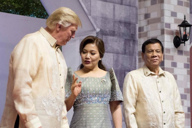 Brief encounters between the two men have appeared to support Duterte's confidence that Trump is not concerned with the killings (AFP Photo/JIM WATSON)