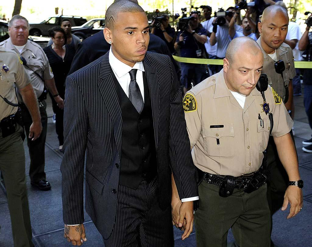"""It's pretty safe to say Chris Brown won't be running for office anytime soon. The R&B singer was formally sentenced to five years' probation and six months of community service Tuesday for assaulting ex-girlfriend Rihanna. Brown, who last week released a song online in which he apologizes and insists he's a changed man, was seen partying at a West Hollywood club after his court appearance. Kevork Djansezian/<a href=""""http://www.gettyimages.com/"""" target=""""new"""">GettyImages.com</a> - August 25, 2009"""
