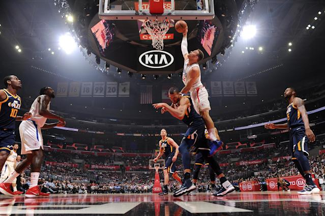 """<a class=""""link rapid-noclick-resp"""" href=""""/nba/players/4561/"""" data-ylk=""""slk:Blake Griffin"""">Blake Griffin</a> drops something memorable on the head and body of <a class=""""link rapid-noclick-resp"""" href=""""/nba/players/5197/"""" data-ylk=""""slk:Rudy Gobert"""">Rudy Gobert</a>. (Andrew D. Bernstein/NBAE/Getty Images)"""