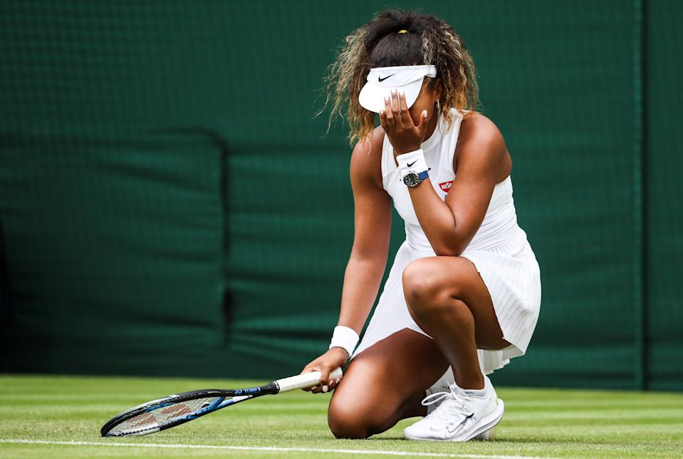 Naomi Osaka of Japan reacts in her Women's Singles first round match against Yulia Putintseva of Kazakhstan during Day one of The Championships - Wimbledon 2019 at All England Lawn Tennis and Croquet Club on July 01, 2019 in London, England. (Photo by Shi Tang/Getty Images)