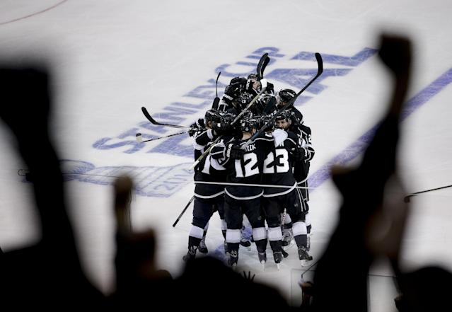 Members of the Los Angeles Kings celebrate Dustin Brown's goal against the New York Rangers during the second overtime period in Game 2 in the NHL hockey Stanley Cup Finals in Los Angeles, Saturday, June 7, 2014. (AP Photo/Jae C. Hong)