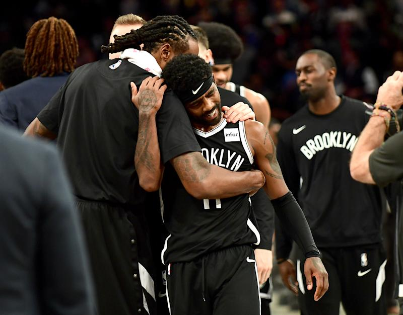 NEW YORK, NEW YORK - OCTOBER 23: DeAndre Jordan #6 hugs Kyrie Irving #11 of the Brooklyn Nets after their 127-126 loss to the Minnesota Timberwolves at Barclays Center on October 23, 2019 in the Brooklyn borough of New York City. NOTE TO USER: User expressly acknowledges and agrees that, by downloading and or using this photograph, User is consenting to the terms and conditions of the Getty Images License Agreement. (Photo by Emilee Chinn/Getty Images)