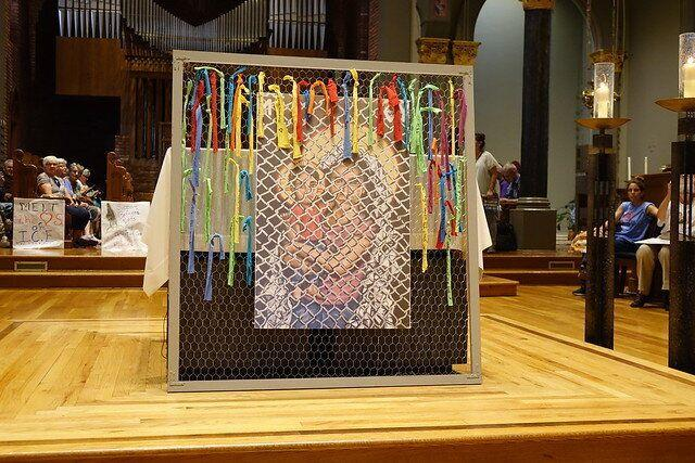 """Kelly Latimore's icon is titled """"Mother of God: Protectress of the Oppressed."""" It is seen here in front of the altar atSt. Mary's Church in Newark. (Photo: Ignatian Solidarity Network)"""