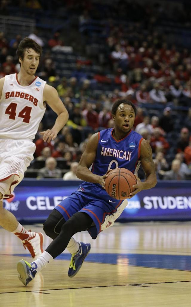 American guard Darius Gardner (0) drives against Wisconsin forward Frank Kaminsky (44) during the first half of a second-round game in the NCAA college basketball tournament Thursday, March 20, 2014, in Milwaukee. (AP Photo/Jeffrey Phelps)