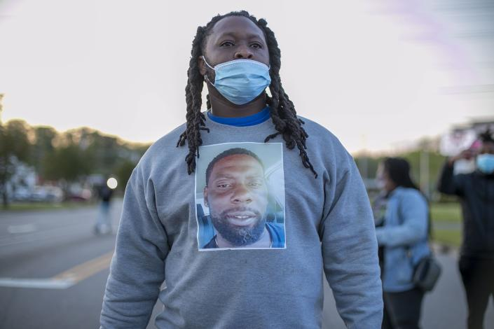 A demonstrator wears a shirt with an image of Andrew Brown Jr. on it during a march, Thursday, April 22, 2021, Elizabeth City, N.C., in reaction to the death of Brown, who was shot and killed by a Pasquotank County Deputy Sheriff earlier in the week. (Robert Willett/The News & Observer via AP)