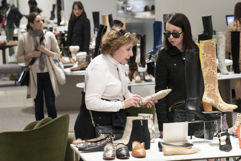 """In this Tuesday, Nov. 26, 2019, photo shows customers shopping in the shoe department at the Nordstrom NYC Flagship in New York. """"Clearly, shopping is much more about an experience,"""" said Jamie Nordstrom, president of Nordstrom stores and the great-grandson of the company's founder. """"It's not just about getting through their lists. They want to bump into something new, something they didn't come into find. I think great stores do that well."""" (AP Photo/Mary Altaffer)"""