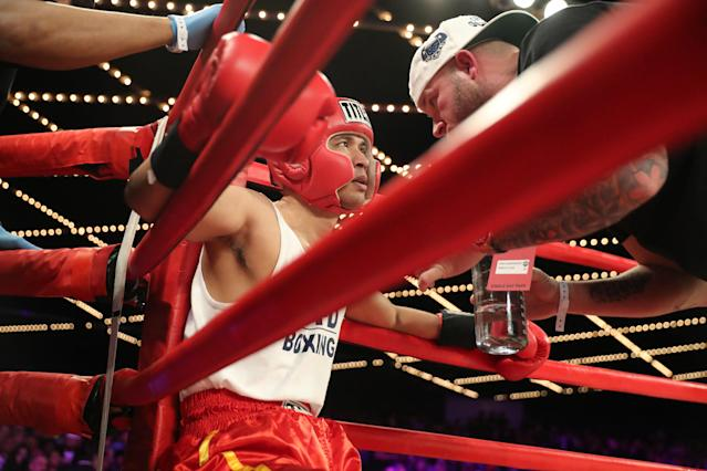 <p>Richie Fuentes gets instructions in between rounds in the CO vs. NCO 72 Supremacy during the NYPD Boxing Championships at the Hulu Theater at Madison Square Garden on March 15, 2018. (Gordon Donovan/Yahoo News) </p>