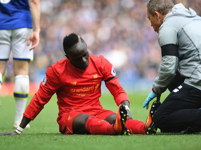 Mane was forced off in the second-half of Liverpool's win against Everton: Getty