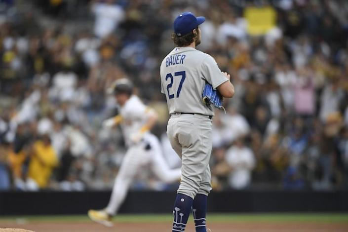 Los Angeles Dodgers starting pitcher Trevor Bauer (27) stands on the mound after giving up a sole home run to San Diego Padres' Jake Cronenworth (9) during the first inning of a baseball game against the San Diego Padres Wednesday, June 23, 2021, in San Diego. (AP Photo/Denis Poroy)