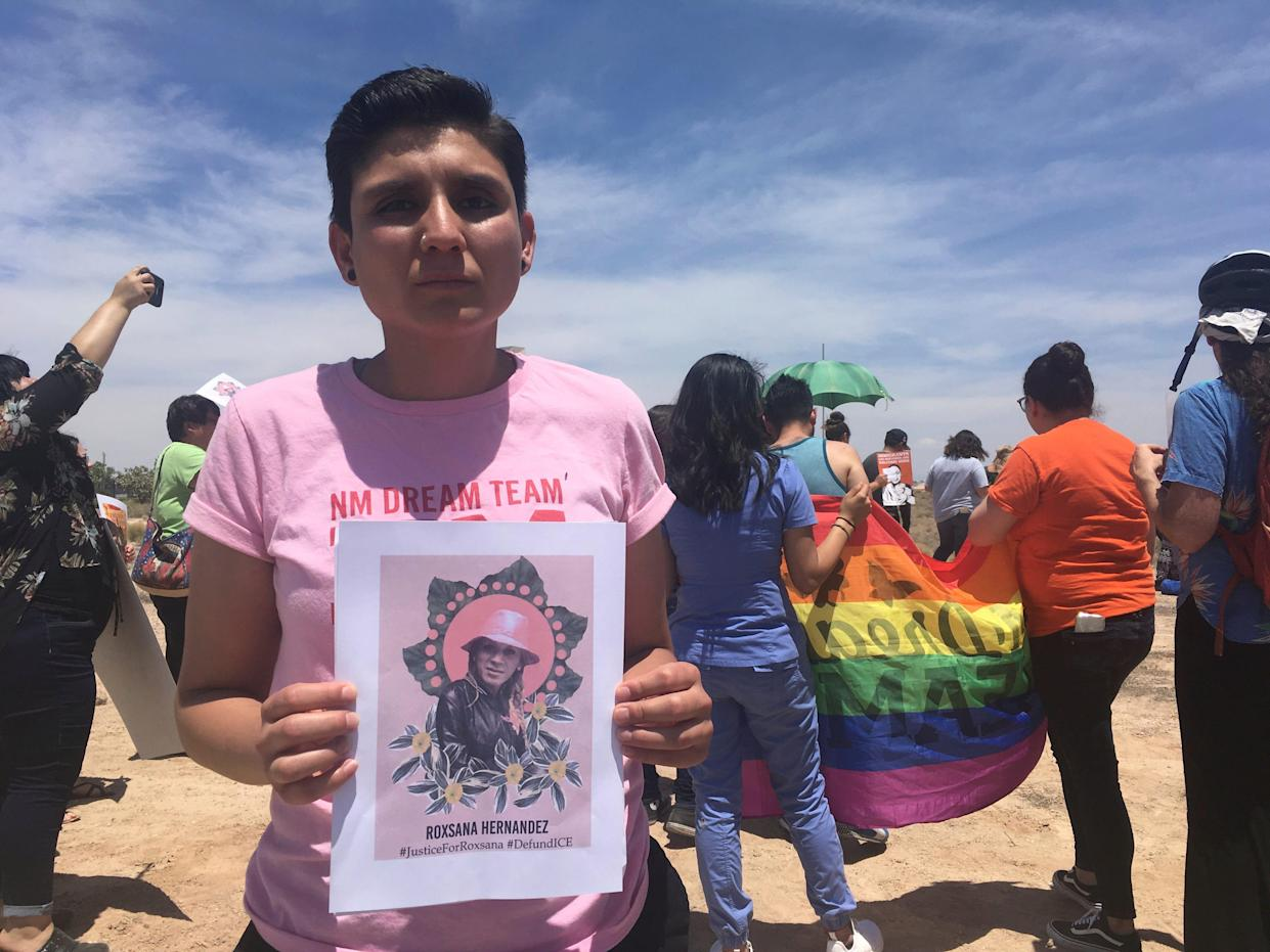 Gabriela Hernandez, executive director of the nonprofit New Mexico Dream Team, holds up an image Wednesday, June 6, 2018, in Albuquerque, N.M, of a Honduran transgender woman who died while in U.S. custody. Immigrant and LGBT advocates gathered outside a U.S. Immigration and Customs Enforcement office in Albuquerque to protest migrant Roxsana Hernandez's death, which authorities say came after she developed symptoms of pneumonia, dehydration and complications associated with HIV. (AP Photo/Mary Hudetz). ORG XMIT: RPMH301
