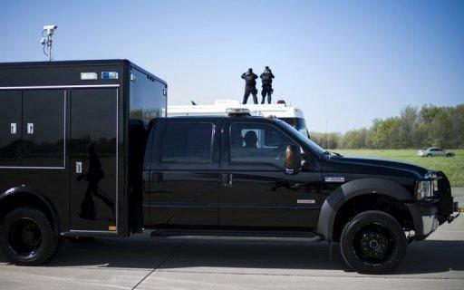 Members of the Secret Service counter sniper team keep watch over US President Barack Obama's motorcade