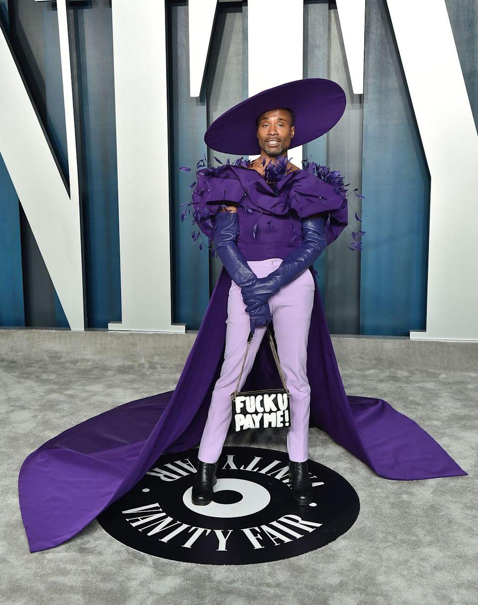 <p>The Oscars performer wore a purple off-the-shoulder top with a cape to the star-studded party. The colour purple has longer been associated with royalty and power.<br>The outfit - created by Christian Siriano - featured feathers on the bust and was teamed with a pair of purple elbow-length gloves, a pair of lilac-coloured cigarette trousers, black heeled boots, a purple Sarah Sokol Millinery wide-brimmed hat and a ThesePinkLips handbag.</p>