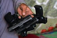 One arms dealer told AFP that the Taliban purchase their stock, and do not let others buy weapons (AFP/JAVED TANVEER)