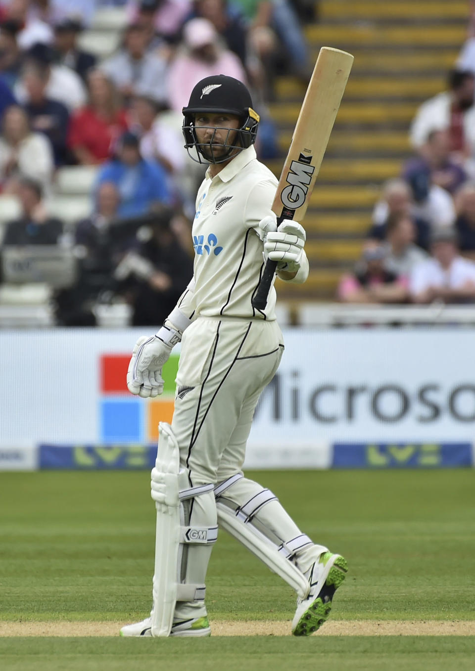 New Zealand's Devon Conway raises his bat to celebrate scoring fifty runs during the second day of the second cricket test match between England and New Zealand at Edgbaston in Birmingham, England, Friday, June 11, 2021. (AP Photo/Rui Vieira)