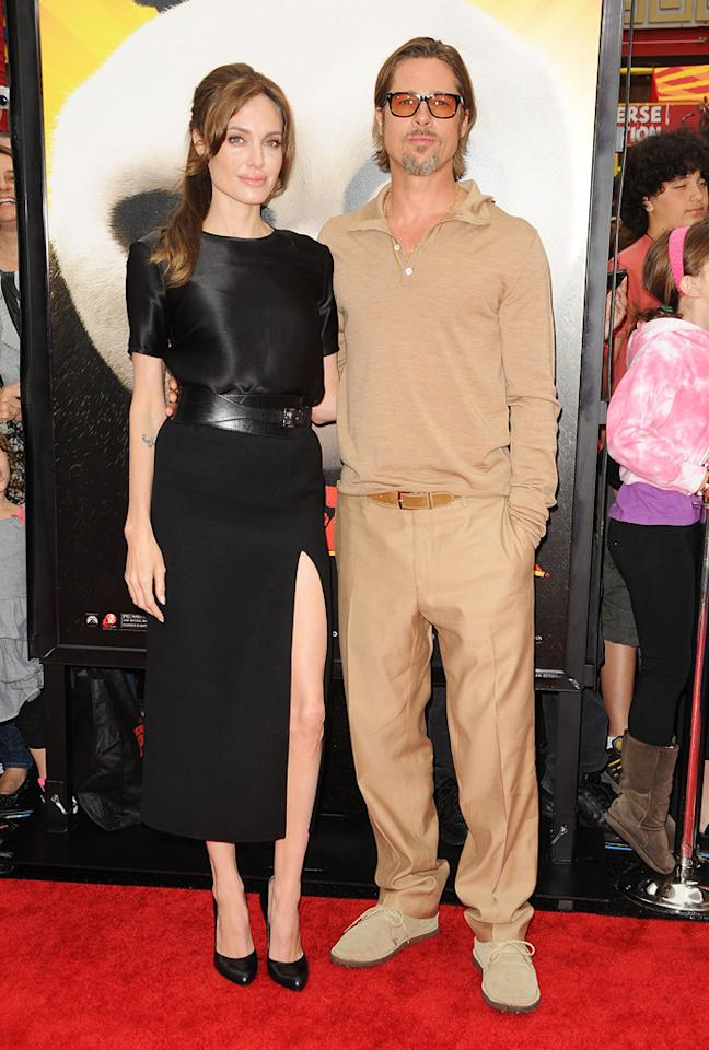 """<a href=""""http://movies.yahoo.com/movie/contributor/1800019275"""">Angelina Jolie</a> and <a href=""""http://movies.yahoo.com/movie/contributor/1800018965"""">Brad Pitt</a> might be their generation's epitome of Hollywood glamour, but they obviously have different tastes in red carpet style. Take, for example, what each of them wore to Sunday's premiere of """"<a href=""""http://movies.yahoo.com/movie/1810090593/info"""">Kung Fu Panda 2</a>"""" in Hollywood.    Yes, it was a family-centered event during the day on a weekend, so it didn't exactly call for fancy duds. But contrast Angelina's look to Brad's. She wore a sleek, short-sleeved black Michael Kors dress along with a high leg slit. She accessorizes with black heels, a belt, and her hair pulled back in a ponytail, creating a graceful and not overdone ensemble. Brad, on the other hand, went past casual to the point of boring: beige sweater, beige khakis (which look too long for him), beige belt, and even beige suede shoes. It looks like he's literally trying to blend into the background."""