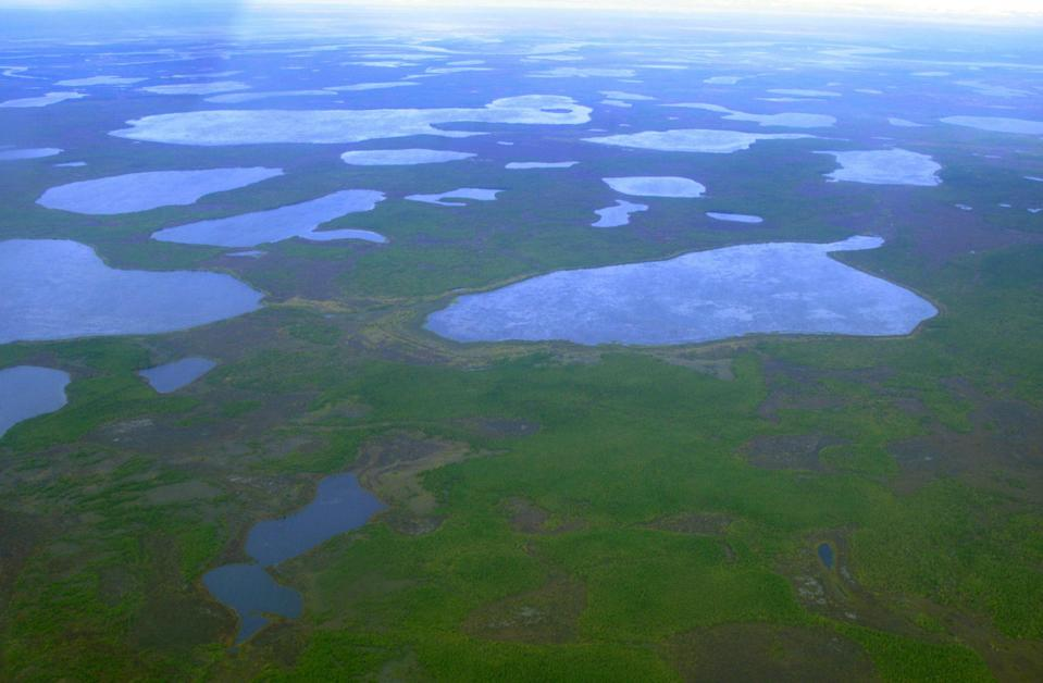 An aerial view shows lakes outside the town of Chersky in northeast Siberia. Climate change is thawing the permafrost (REUTERS)