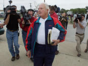 FILE - In this Oct. 21, 2002 file photo, former Louisiana Gov. Edwin Edwards walks to his car outside the Federal Medical Center in Fort Worth, Texas, after talking with reporters before checking into the prison. Edwards, the high-living four-term governor whose three-decade dominance of Louisiana politics was all but overshadowed by scandal and an eight-year federal prison stretch, died Monday, July 12, 2021, of respiratory problems. He was 93. (AP Photo/Donna McWilliam, File)