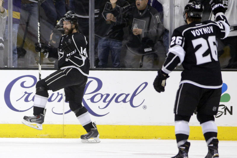 Los Angeles Kings right wing Justin Williams, left, celebrates his goal against the New York Rangers during the first period in Game 5 of the NHL Stanley Cup Final series Friday, June 13, 2014, in Los Angeles. (AP Photo/Jae C. Hong)
