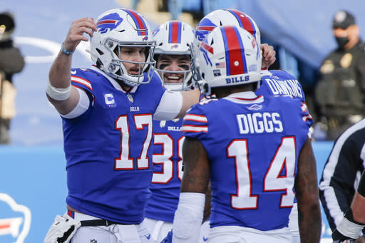 Buffalo Bills' Josh Allen (17) celebrates with teammate Stefon Diggs (14) after scoring a touchdown during the first half of an NFL wild-card playoff football game against the Indianapolis Colts Saturday, Jan. 9, 2021, in Orchard Park, N.Y. (AP Photo/Jeffrey T. Barnes)