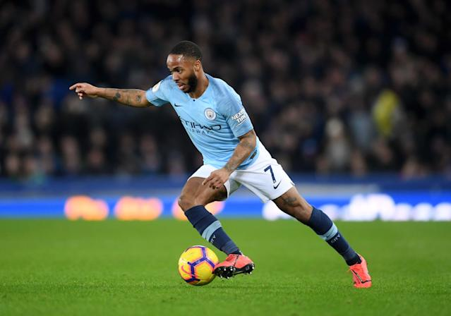 Man City's Raheem Sterling runs on the ball (Photo by Laurence Griffiths/Getty Images)