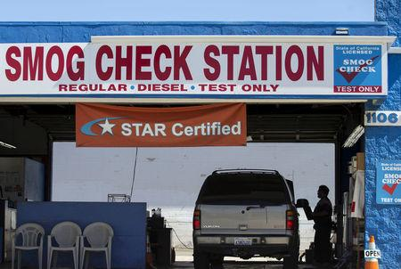 FILE PHOTO: A vehicle has its emissions tested at a smog testing facility in Oceanside