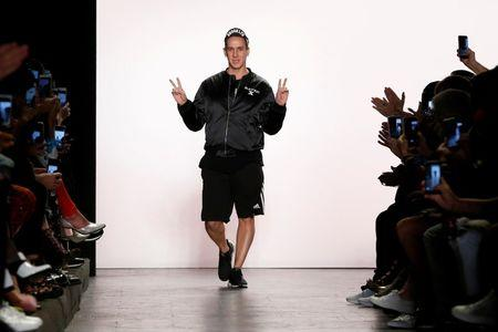 Designer Jeremy Scott gestures after a presentation of his Spring/Summer 2017 collection during New York Fashion Week in the Manhattan borough of New York, U.S. September 12, 2016. REUTERS/Lucas Jackson