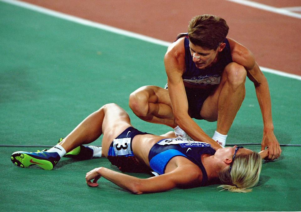 30 Sep 2000: Marla Runyan of the USA helps compatriot Suzy Favor Hamilton after the Womens 1500m Final at the Olympic Stadium on day 15 of the Sydney 2000 Olympic Games in Sydney, Australia. \ Mandatory Credit: Shaun Botterill /Allsport