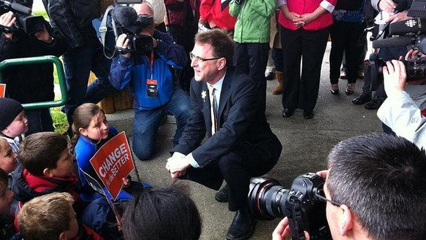 B.C. NDP Leader Adrian Dix chats with future voters in Comox on Thursday after pledging $372 million in new education & child care funding.
