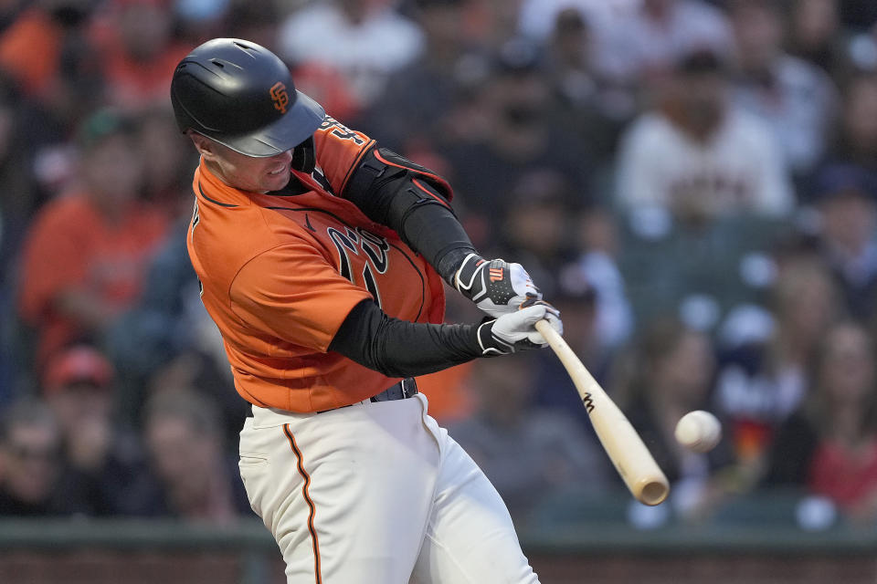 San Francisco Giants' Buster Posey hits an RBI double against the Houston Astros during the third inning of a baseball game Friday, July 30, 2021, in San Francisco. (AP Photo/Tony Avelar)