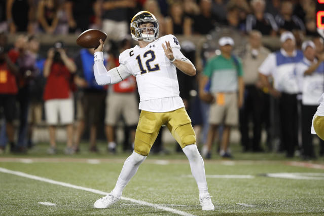 """A pass from Notre Dame quarterback <a class=""""link rapid-noclick-resp"""" href=""""/ncaaf/players/271127/"""" data-ylk=""""slk:Ian Book"""">Ian Book</a> sailed and hit a Louisville cheerleader in the face. (Photo by Joe Robbins/Getty Images)"""