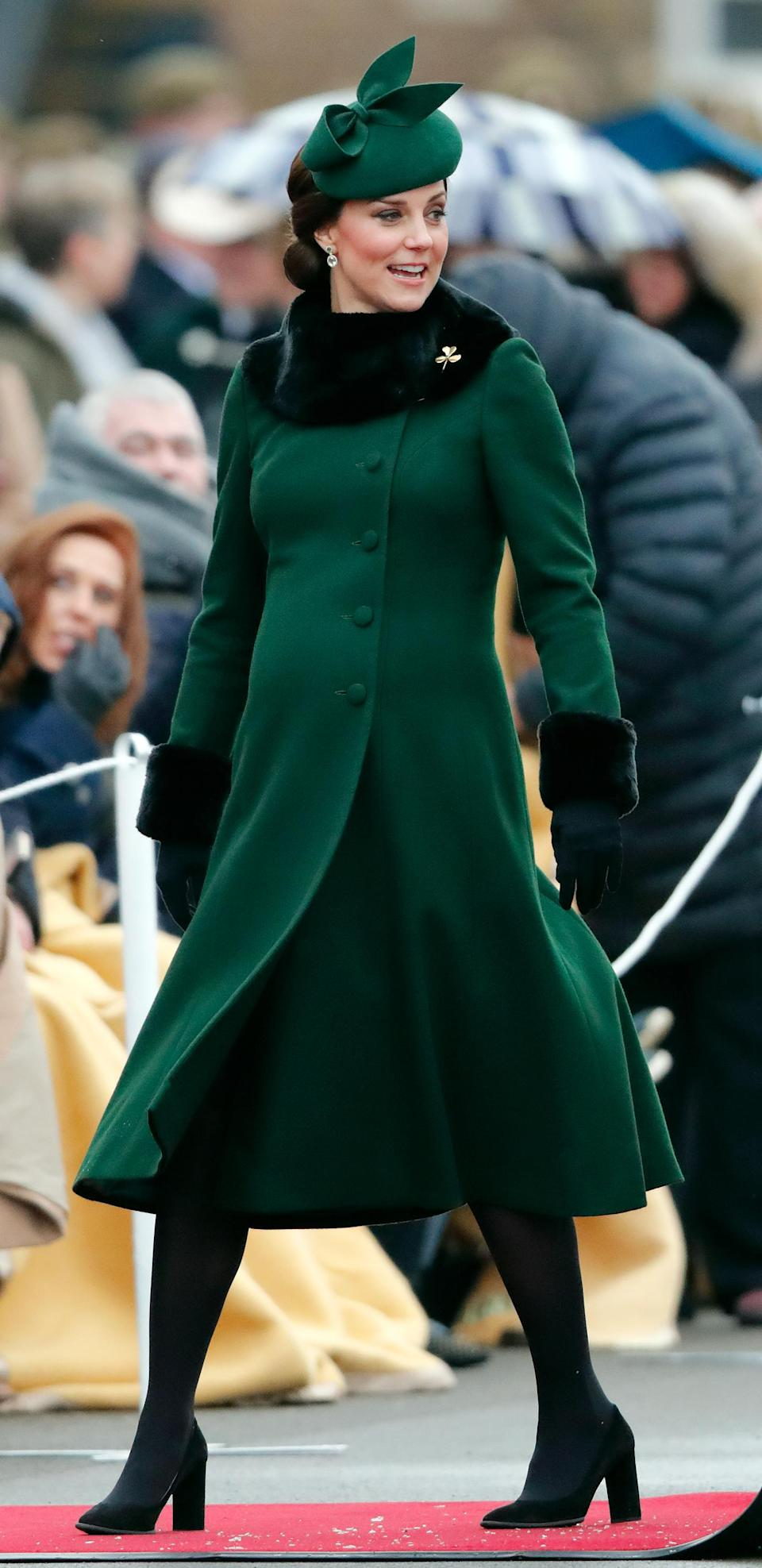 <p>On March 17, the Duchess of Cambridge wrapped up to celebrate St Patrick's Day in a suitably green Catherine Walker coat and Gina Foster hat. <em>[Photo: Getty]</em> </p>